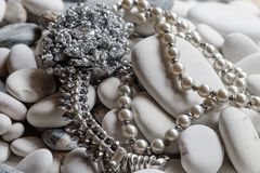 Silver jewelry with necklace of pearls royalty free stock photography