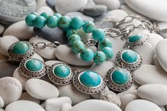 Silver jewelry on pebbles Royalty Free Stock Photo