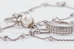 Silver jewelry: ring, earrings and chain Royalty Free Stock Photography