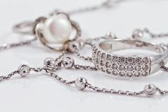 Silver jewelry: ring, earrings and chain Royalty Free Stock Images
