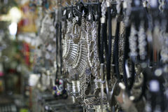 Silver jewelry in the shop Stock Photography