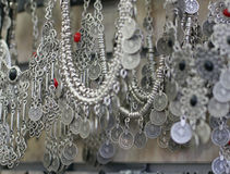 Silver jewelry in the shop Stock Photos