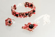 Silver jewels with colorful precious stones Royalty Free Stock Photography