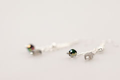 Silver jewels with colorful precious stones stock images