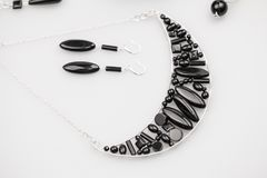 Silver jewels with onyx stones Stock Images