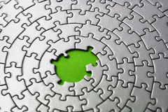 Silver jigsaw with missing pieces in the center Stock Photo