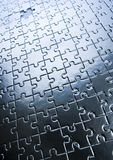Silver jigsaws Stock Image