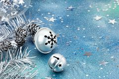 Silver jingle bells with christmas tree branches and decoration Royalty Free Stock Photos