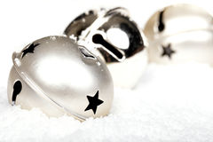 Silver jingle bells in the snow Royalty Free Stock Photo