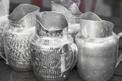 SILVER JUG. Ancient jug milk pattern reflection silver water white Stock Images