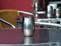 Silver jug. On the table in a restaurant Royalty Free Stock Image
