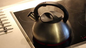 Silver Kettle is boiling on the electric hotplate. stock video