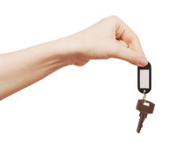 Silver key with blank tag in hand Stock Images