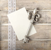 Silver key diary greeting card. Silver key on wooden diary greeting card Royalty Free Stock Photo