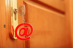 Silver key with e-mail symbol Royalty Free Stock Image