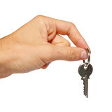 Silver key in a hand. Silver key in a hand isolated on white Stock Image