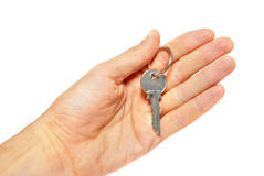 Silver key in a hand Royalty Free Stock Images