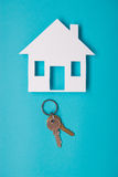 Silver key with house figure Stock Images