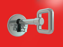 Silver key in keyhole Stock Photos