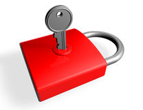 Silver key in the lock of a red padlock Stock Image