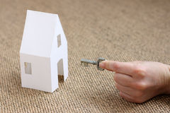 Silver key and paper house Stock Photos