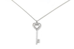 Silver key pendant necklace Stock Images