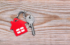 Silver key with red house figure Stock Photography