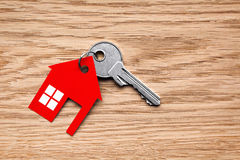 Silver key with red house figure Royalty Free Stock Image
