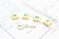 Silver key and word home on housing plan Royalty Free Stock Photo