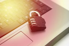 Silver keyboard with closed padlock, technical assistance and computer repairs, golden light stock photo