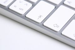Silver keyboard with white key push button. Background closeup royalty free stock image