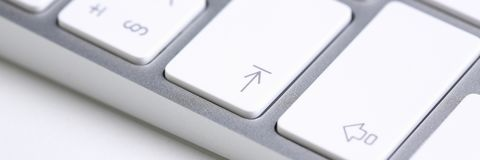 Silver keyboard with white key push button. Background closeup royalty free stock photo