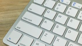 Silver keyboard  on wood table flat lay image. The  silver keyboard  on wood table flat lay image royalty free stock image