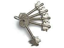 Silver keys. Five silver keys on a keyring royalty free stock images