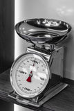 Silver kitchen scales with a red arrow on the shelf Stock Photography