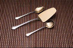 Silver kitchen utensils for dessert. Teaspoon, shovel cake and spoon for sugar. Stock Images