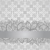 Silver lace border on floral silver wallpaper Royalty Free Stock Photo
