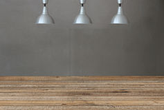 Silver lamps on the ceiling and a backdrop on a concrete wall wi Stock Image