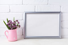 Silver landscape frame mockup with purple flowers in pink rustic royalty free stock image