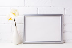 Silver landscape frame mockup with soft yellow orchid in vase stock images