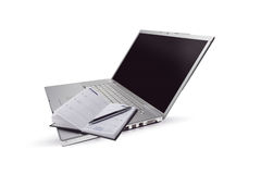 Silver lap top and opened pocket planner Royalty Free Stock Photo