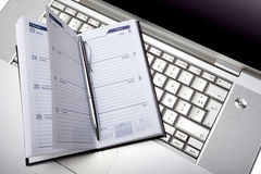 Silver lap top and pocket planner Royalty Free Stock Images