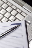 Silver lap top and pocket planner close up Royalty Free Stock Photo