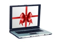 Silver laptop. With illustration of red bow on LCD on white background royalty free stock photo