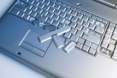 Silver laptop with broken keyboard. A close-up picture of part of broken laptop.  royalty free stock photography