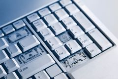 Silver laptop with broken keyboard. A close-up picture of part of broken laptop.  royalty free stock images