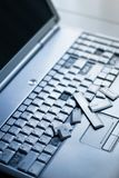 Silver laptop with broken keyboard. A close-up picture of part of broken laptop.  stock images