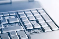 Silver laptop with broken keyboard. A close-up picture of part of broken laptop.  royalty free stock photo