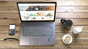 Silver Laptop Next to Coffe Cup Smartphone and Glasses Stock Photography