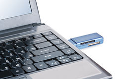 Silver laptop with usb flash drive Stock Photography